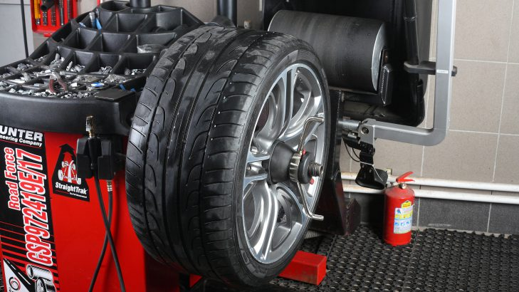 bigstock-Car-Service-Balancing-Tire-Wh-112261343 Cropped