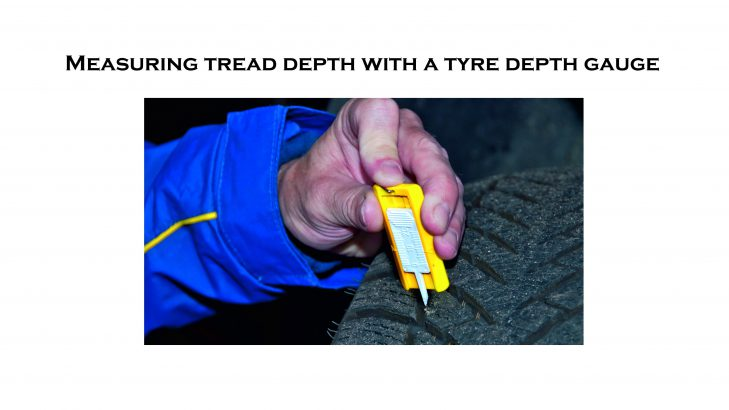 measuring tread depth with a tyre depth gauge