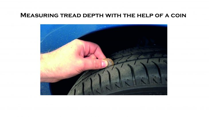 measuring tyre tread depth with coin